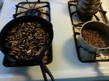 Cooking the mushrooms and boiling the wild rice.
